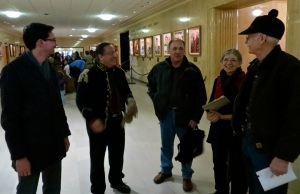 Individuals concerned about what happens to the Killdeer Mountains chat before the public hearing at the Bismarck capitol on January 24, 2013.