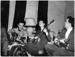 Left to right, Sonny Terry (obscured), Woody Guthrie, Lilly Mae Ledford and Alan Lomax in New York, 1944. Photo online with The Library of Congress, Alan Lomax Collection.