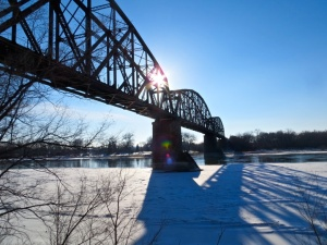 Historic railroad bridge, looking west toward the winter sun getting ready to set.