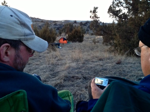 Andrew Reinhard at left has Richard Rothaus go over his photos from another 10+ mile leg of Adventure Science's 100 miles of North Dakota Wild.