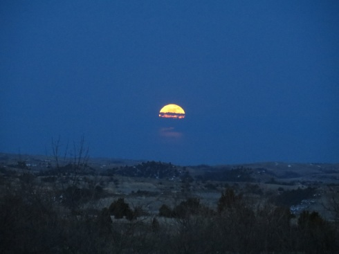 Not long after the sun set in the west, I looked to the east and saw this moon rising.