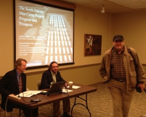 Bret Weber and Bill Caraher prepare to present man camp findings to NDSU in the Spring of 2013. Tom Isern pictured at right saunters back to take a seat.