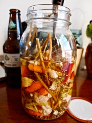 Getting pickled with jars of local farmer's market pickled vegetables.