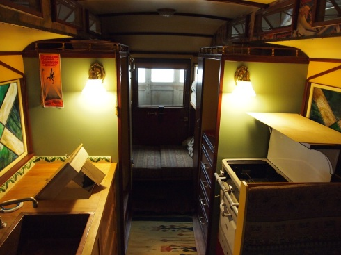 An interior shot of the sweet circus ride. Note the stove range to the right; sink to the lower left; toilet further back; and bed at the way back.