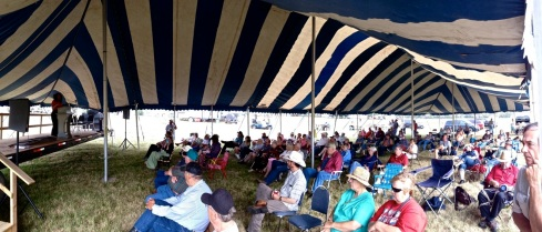 Under the tent, the morning at Whitestone Hill. Ladonna is speaking at left.