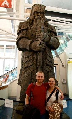 Matt and Molly stand below a modest Lord of the Rings statue at the airport in Auckland, New Zealand. The Lord of the Rings was filmed in New Zealand.