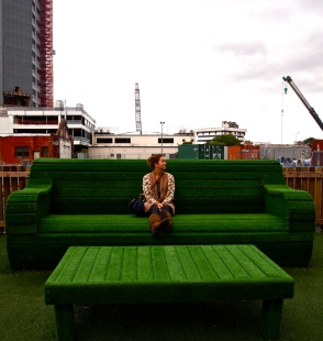 Public Art that impressionistically simulates an outdoor living room in Cathedral Square, Christchurch. Molly McLain is obliging the artists, and taking it all in.