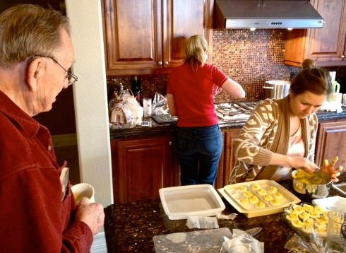 Kitchen busy work on Christmas Eve. Great Grandpa Christy chats with Carmel and Molly.