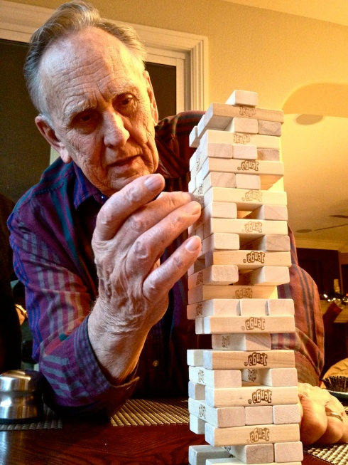 Grandpa Christy brings 86 years of experience to the Jenga tower on Christmas Day.