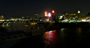 The Mississippi River reflects the neon Gold Medal Flour signage (among other signs). Photo taken from the Central Avenue NE bridge, view to the south.