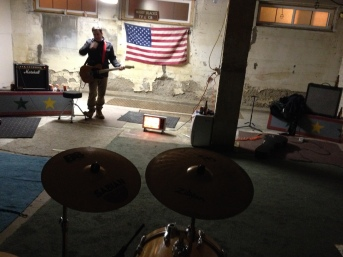 From behind the drums in the Les Dirty Frenchmen practice room. Photo from December 2013.